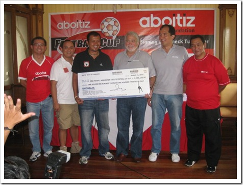aboitiz foundation turn over check funding the foot cup of cebu football association