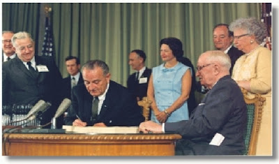 LBJ signs Medicare into law, photo from SSA