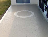 patio_concrete_stain_tile_cut_circular_brick.jpg