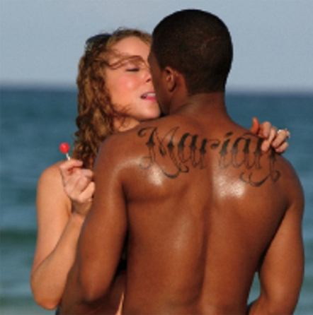 Last name tattoos on back.
