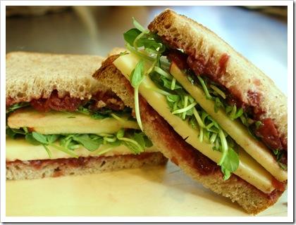 sandwich, adirondack cheddar, migliorelli honeycrisp apple, beth's farm cranberry horseradish chutney, little seed garden pea shoots