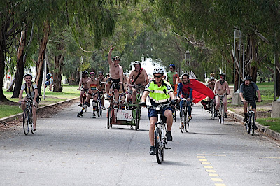 Naked cyclists on Federation Mall, Canberra