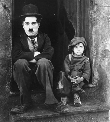 Chaplin and Jackie Coogan in the movie The Kid