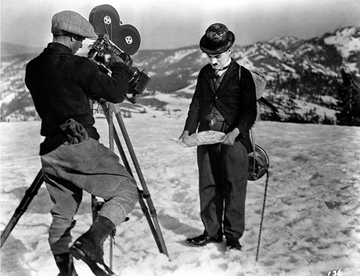 Chaplin and a cameraman during the filming of Alaska