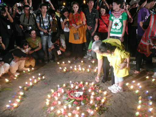 """‎After decades of conflict, long awaited Peace Talks are set to resume between the Government of the Philippines and the Moro Islamic Liberation Front (also with the National Democratic Front and the Moro National Liberation Front).</p> <p>Four hundred children from diverse faith backgrounds gathered with artists, ritual leaders and indigenous musicians to channel the power of art and ritual for peace building. On February 7th, 2011 the children were invited to craft terra-cotta candle and flower holders inspired by the Tri-People culture of Mindanao.</p> <p>The next day the children were joined by the President of the Philippines, leaders of the military, universities, police, government agencies, and NGOs for a ritual lighting of a peace mandala of candles featuring their clay creations. It was the call of the children to end armed conflict in their generation. It was a celebration of the end of the cycle of war, misunderstanding, and separation. It was a reminder of our interconnection across lines and generations. United, one light at a time, peace will shine."