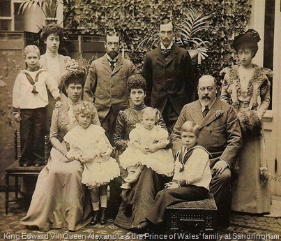 King Edward VII, Queen Alexandra and the Princess of Wales, later Queen Mary, are seated from right to left. The Prince of Wales, later King George V, is standing between his wife and mother.