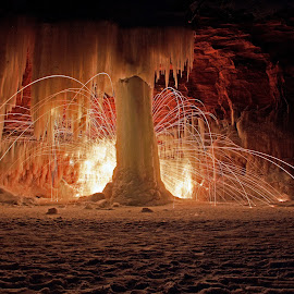 Ice Pillar by Jamie Rabold - Abstract Light Painting ( ice caves, light painting, steel wool, spinning fire, south shore, lake superior, sparks )
