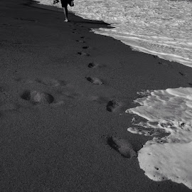 by Suzana Dordea - Instagram & Mobile iPhone ( shore, sand, black and white, waves, feet, footsteps )