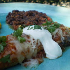 Tomato Sauced Enchiladas With Sour Cream and Aged Cheese