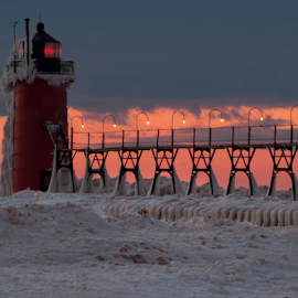 Lake Michigan Sunset by Kelly Alholinna - Buildings & Architecture Other Exteriors ( michigan, winter, lighthouse, frozen, south haven )