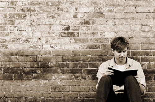 young man reading, image by Sarah Cates