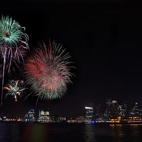 Fireworks over Boston by Jeff Stallard - City,  Street & Park  Night ( skyline, boston, labor day, fireworks, massachusetts, waterfront )