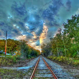 Take me there by Dipali S - Transportation Railway Tracks ( waterscape, direction, transportation, landscape, gravel, usa, colour image, photography, sky, tree, nature, autumn, no people, creek, dramatic, empty, clouds, park, hdr, absence, journey, forest, woods, railway track, michigan, horizontal, fall, outdoors, trees, cloud, day, river )
