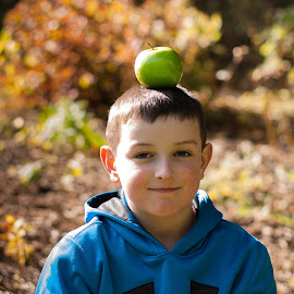 An Apple a Day by Jennifer Bacon - Babies & Children Child Portraits ( balance, apple, fall, candid, people, boy )