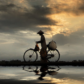 nuntun by Indra Prihantoro - Transportation Bicycles ( bicycles, sunset, women )
