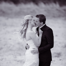 Kiss me at sunset by Lodewyk W Goosen-Photography - Wedding Bride & Groom ( love, in love, kissing, nature, windy, black and white, wedding, love forever, fields, couples )