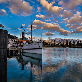 Lady of the Lake by Pete Whittaker - Landscapes Waterscapes ( clouds, reflection, mountain, lake, landscape, boat, new zealand )