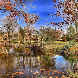 Autumn Afternoon by Kimberly Davidson - Landscapes Waterscapes ( michigan, cement bridge, waterscape, autumn, fall, bridge, river, mccourtie park, fall color, color, colorful, nature )