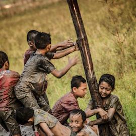 They are enjoying their world. by Krisdian Isnu Wardana - Babies & Children Children Candids ( child, children candids, child photography, children )
