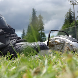 end game by Lindsay Jones - Novices Only Sports ( grass, cleats, baseball, equipment, close up )