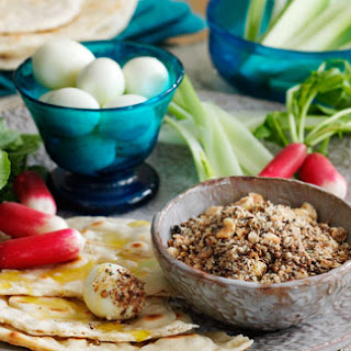Quail's eggs with Dukkah, vegetables and flatbread