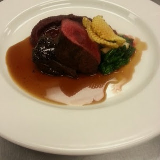 Seared Venison Served With Red Current Red Wine Sauce Beetroot Puree, Spinach And Potato Chip