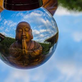 Crystal Buddha by JP Miles - Artistic Objects Glass ( calm, clouds, ball, crystal ball, wood, relax, crystal, buddha, religion, tranquil, buddhism, time, statue, sky, blue, time lapse, zen, praying, glass, pray, yoga, religious )