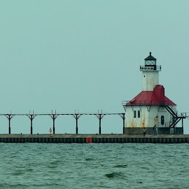 Pier at Silver Beach, St. Joseph, MI by Lori Rider - Landscapes Waterscapes ( water, lake michigan, waves, lighthouse, pier )