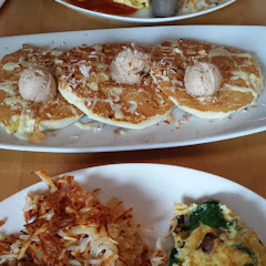 hubby's gluten meal on the left. Hawaiian GF pancakes center and my gf omelet/muffin on the right.