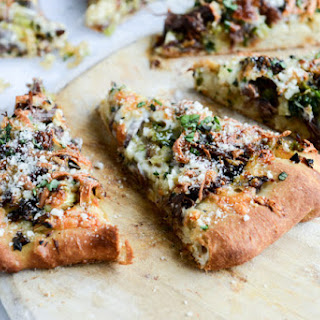 Crispy Shredded Sprouts, Cider Short Rib and Caramelized Shallot Pizza