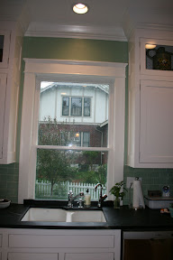 Sink in front of low window / banquette / old house - Kitchens