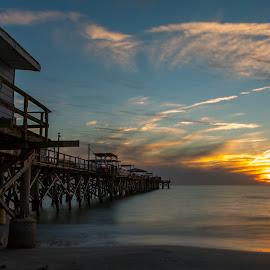 Long Pier at Sunset by Bill Kuhn - Buildings & Architecture Bridges & Suspended Structures ( shore, long pier, reflection, tampa, sun, redington long pier, florida, sunset, gulf, wave, pier, long exposure, redington )