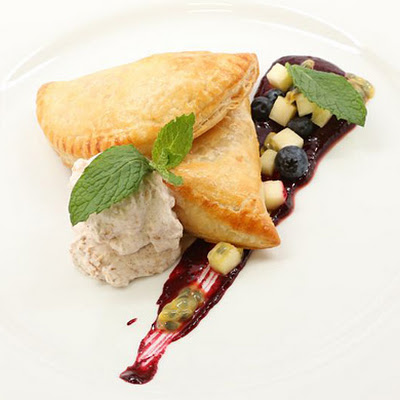 White Chocolate Passion Fruit Turnovers with Blueberry-Mint Sauce and Coconut Cream