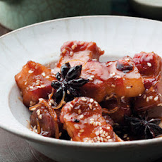 Sticky Szechuan pork with sesame seeds
