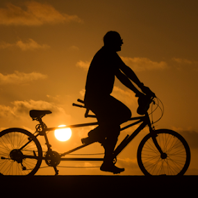 Cyclists at sunset by Yuval Shlomo - Sports & Fitness Cycling
