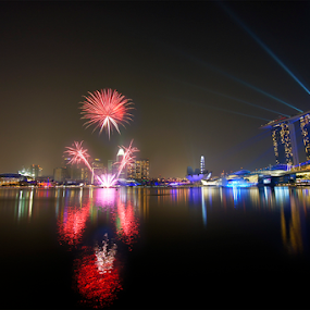 Fireworks over Marina Bay by Jenny Zhang - City,  Street & Park  Night ( festive, skyline, new year, colorful, joy, travel, architecture, cityscape, party, marina bay, attraction, singapore, business, city, modern, explode, sky, happy, event, asia, year, festival, celebrate, light, building, anniversary, colors, tourism, fire, holiday, urban, new, explosion, outdoor, fireworks, night, celebration, waterfront, success )