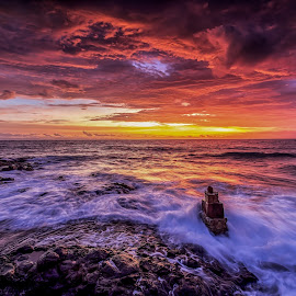 kaprusan beach NTB by Didik Putradi - Landscapes Sunsets & Sunrises ( clouds, sky, sunset, beach, burning, rocks )