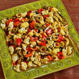 Roasted Cauliflower with Red Bell Pepper, Green Olives, and Pine Nuts (Christmas Caulifiower)