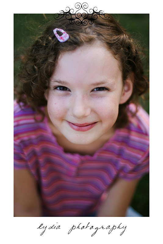 Little girl smiling at lifestyle kids portraits on a farm in Indiana, Pennsylvania