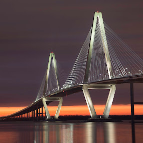Sunset Under the Ravenel Bridge by Bonnie Davidson - Landscapes Sunsets & Sunrises ( orange, charleston, photograph, mount pleasant, sunset, silver, suspension, ravenel bridge, bridge, south caroline, landscape,  )