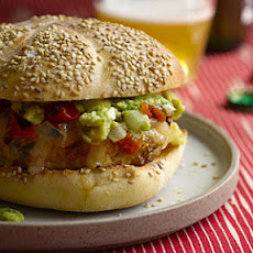 Chicken Burgers With Guacamole, Cheddar, and Charred Tomatoes