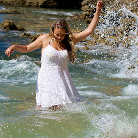 by James Blyth Currie - People Portraits of Women ( water, girl, canon7d, splash, waves, sea, canon70-200mm, algarve, albufeira, portugal, women, rocks )