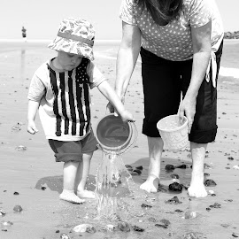 dont spill the water! by Andrew Barnes - Novices Only Portraits & People ( water, sand, bucket, nanny, beach )