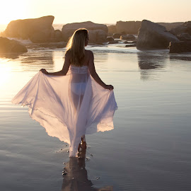 Walking into sunset by Peter Wilkins - People Portraits of Women ( reflection, girl, sunset, sea, white dress, beach, rocks )