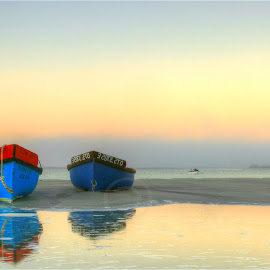 Early Bird catches the worm by Maricha Knight van Heerden - Landscapes Beaches ( paternoster, wooden boats, fishing boats, south africa, low tide, west coast, two blue boats, dawn on the beach, reflection in water, western cape )