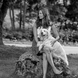 Sasha and Heidi by Jørn Lavoll - Animals - Dogs Portraits ( black and white, woman, dog, portrait, golden retriever )
