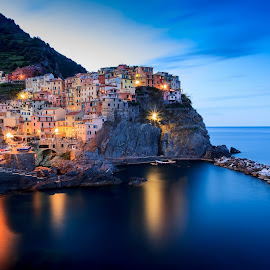 Manarola by Zoltan Duray - Landscapes Waterscapes ( cinque terre, europe, sea, travel, b+w, nd-10stop, dusk, holiday, sky, village, italia, blue, summer, sunrise, manarola, italy, rocks )