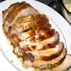 Rosemary-Scented Pork Loin Stuffed With Roasted Garlic, Dried Apricots and Cranberries and Port Wine Pan Sauce
