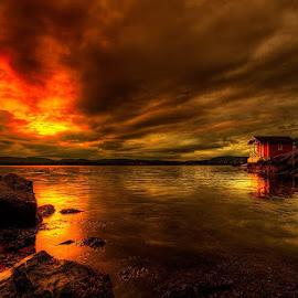 Maybe  http://batinterior.no/batutstyr/kolleksjoner/john-aavitsland-fotografier.html by John Aavitsland - Landscapes Sunsets & Sunrises