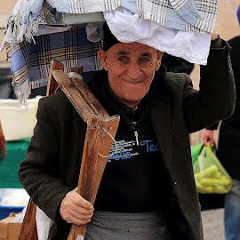 Bread seller by George Marcu - City,  Street & Park  Street Scenes ( street seller, bread seller, turkey, old people, city,  )